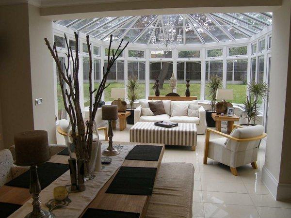 Фото: зимний сад в доме. Дом с пристроенной стеклянной верандой