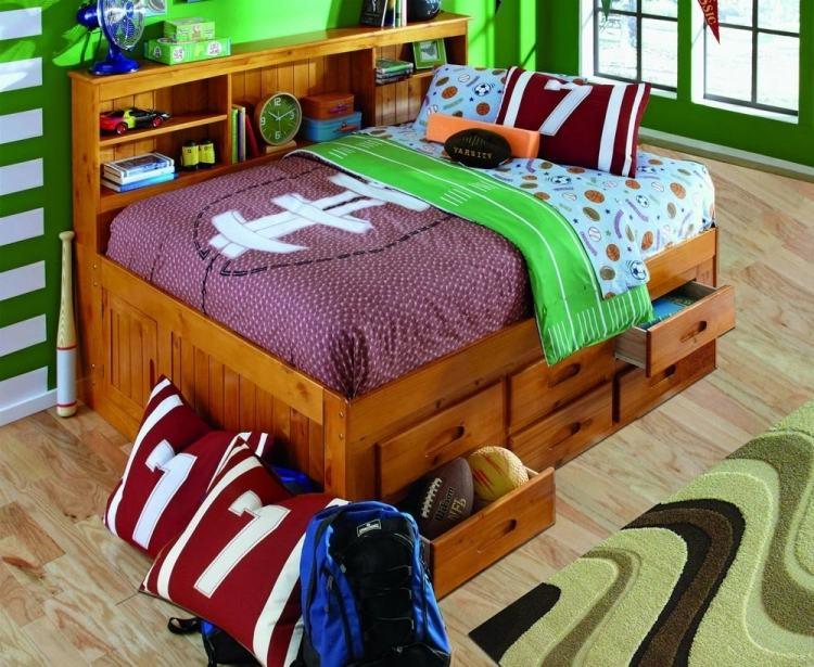 полуторная кровать с выдвижными ящиками для хранения фото идеи для маленькой спальни