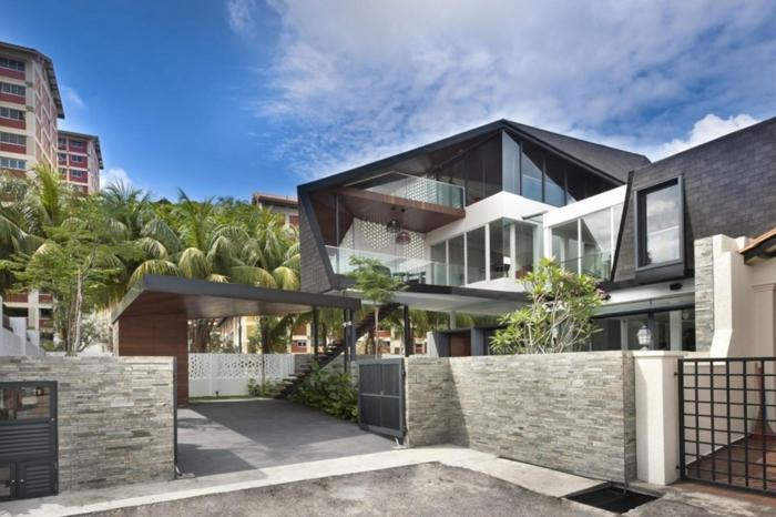 3Д-модель дома и забора, облицованных фасадной плиткой под камень