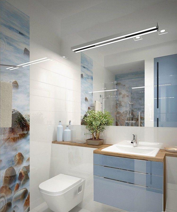 Идея интерьера маленькой ванной комнаты с белой плиткой и небесно-голубыми фасадами фото