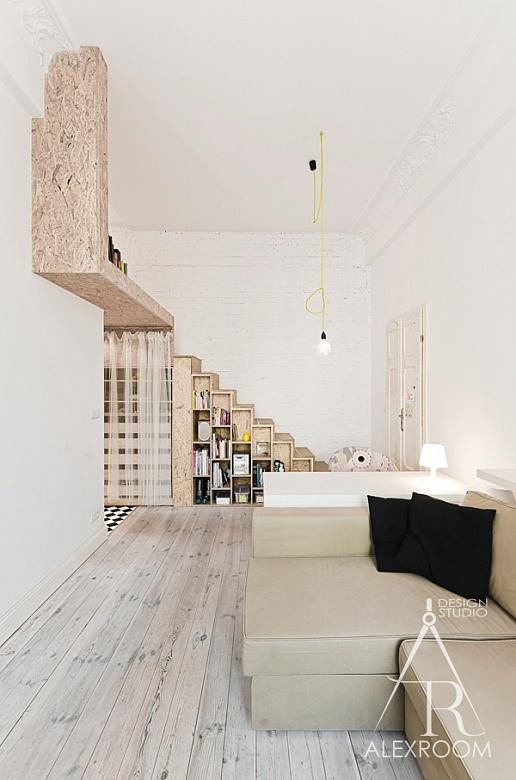 интерьер однокомнатной квартиры студии 30 кв м два яруса кирпичная стена полки хранение рабочий стол