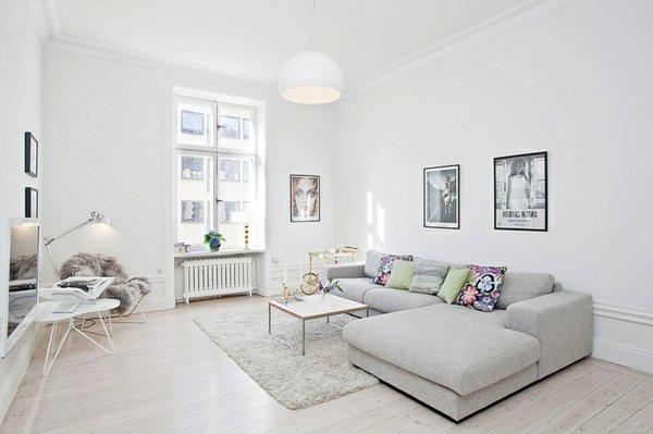 серый угловой диван в гостиной фото скандинавский стиль