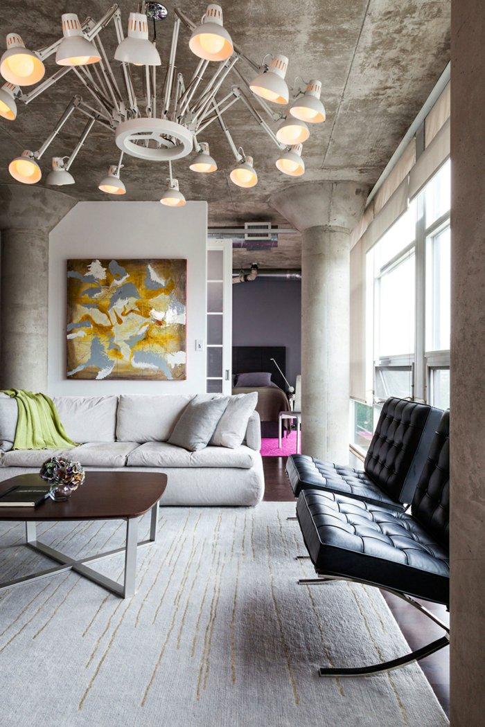 интерьер квартиры в стиле лофт фото гостиная люстра из ламп серый диван ковер